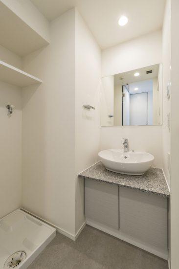 名古屋市北区のワンルームマンションの洗面台の上の丸いボウルがかわいい洗面室