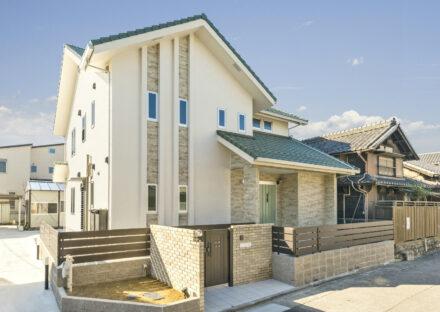 名古屋市南区の注文住宅の緑色の三角屋根が特徴の外観デザイン