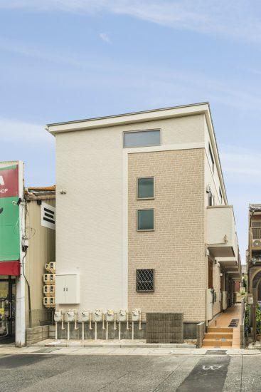 名古屋市緑区のロフト付き賃貸アパートのレンガ模様のある外観デザイン