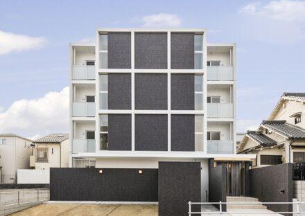 名古屋市名東区の賃貸マンションのモノトーン調のモダンなデザインの賃貸マンション写真